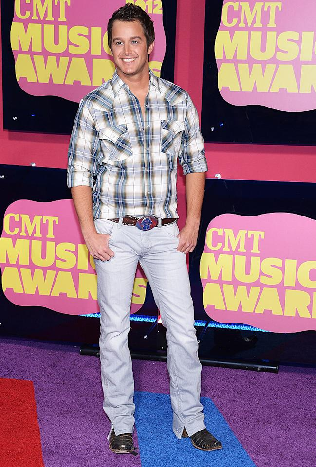 "<p class=""MsoNormal"">Yeehaw! ""A Little More Country Than That"" singer Easton Corbin embraced his true cowboy with a plaid button-down shirt, jeans, and oversized belt buckle. </p>"