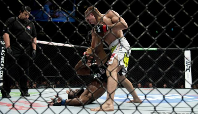 Rory MacDonald, of Canada, pins Tyron Woodley, of the United States, to the mat during the welterweight bout at UFC 174 in Vancouver, British Columbia, Saturday, June, 14, 2014. (AP Photo/The Canadian Press, Jonathan Hayward)