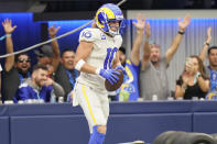 Los Angeles Rams wide receiver Cooper Kupp (10) stands in the end zone after scoring a touchdown during the second half of an NFL football game against the Tampa Bay Buccaneers Sunday, Sept. 26, 2021, in Inglewood, Calif. (AP Photo/Jae C. Hong)