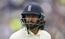 England's Haseeb Hameed leaves the field after losing his wicket during the second day of third test cricket match between England and India, at Headingley cricket ground in Leeds, England, Thursday, Aug. 26, 2021. (AP Photo/Jon Super)