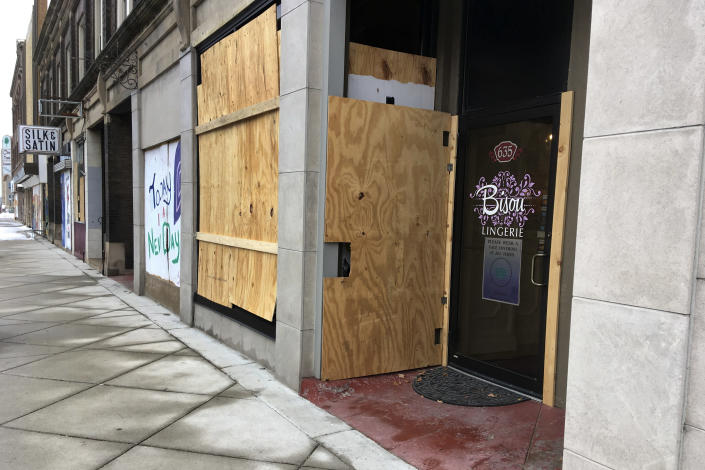 Bisou Lingerie is boarded up in Kenosha, Wis., Thursday, Jan. 7. 2021. The chaotic protests that everyone feared would ensue after a prosecutor decided this week not to charge a Wisconsin police officer who shot Jacob Blake, a Black man, in the back haven't materialized as activists bide their time after right-wing extremists stormed the U.S. Capitol. (AP Photo/Mike Householder)