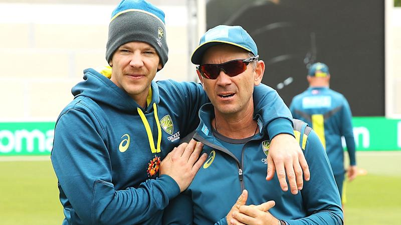 Australian cricket captain Tim Paine and coach Justin Langer are seen here embracing at a practice session.