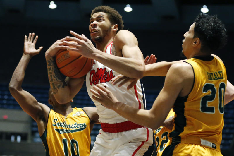 Mississippi forward KJ Buffen (5) protects a rebound from Southeastern Louisiana forward Brandon Gonzalez (20) and guard Von Julien (10) during the first half of an NCAA college basketball game, Saturday, Dec. 21, 2019, in Jackson, Miss. Mississippi won 83-76. (AP Photo/Rogelio V. Solis)