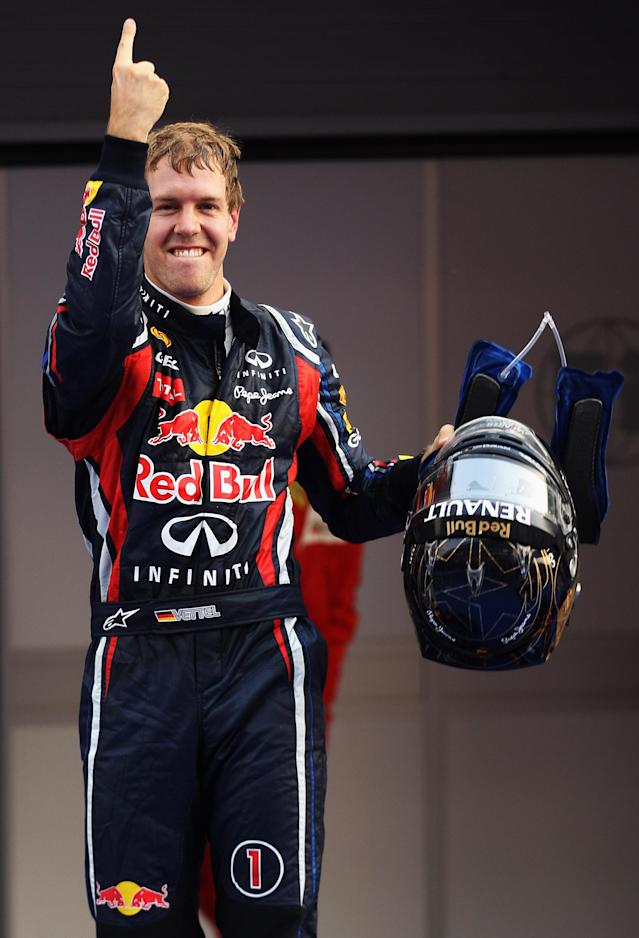 YEONGAM-GUN, SOUTH KOREA - OCTOBER 16: Sebastian Vettel of Germany and Red Bull Racing celebrates in parc ferme after winning the Korean Formula One Grand Prix at the Korea International Circuit on October 16, 2011 in Yeongam-gun, South Korea. (Photo by Mark Thompson/Getty Images)