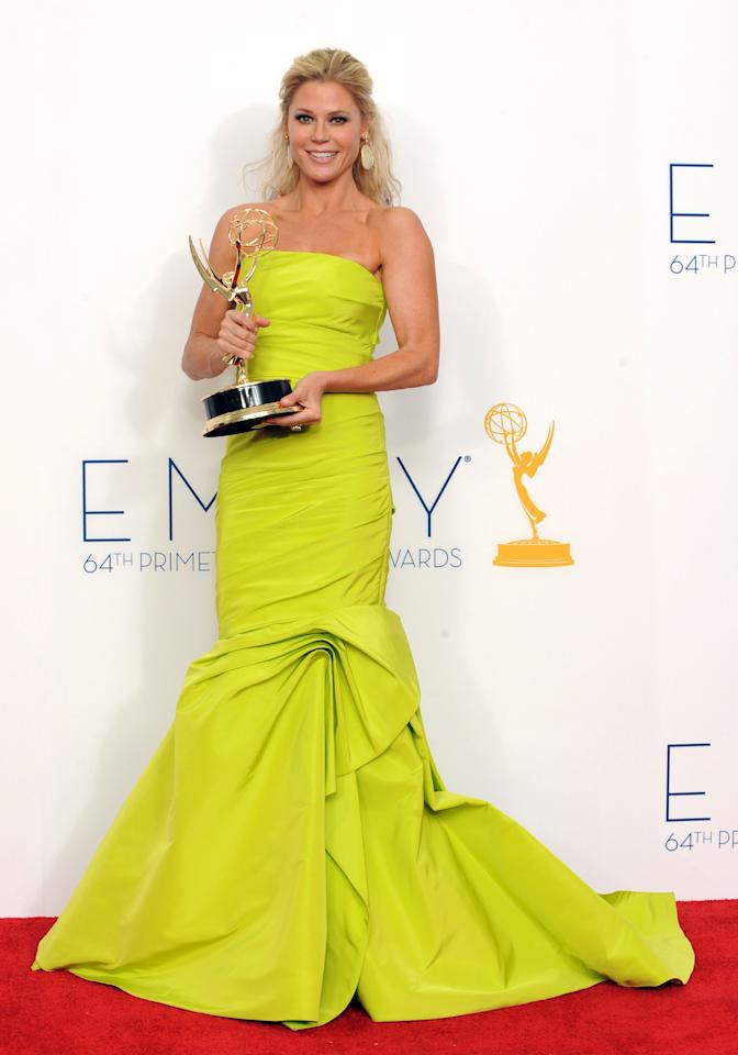 """Julie Bowen poses backstage with her award for best supporting actress in a comedy series for """"Modern Family"""" at the 64th Primetime Emmy Awards at the Nokia Theatre on Sunday, Sept. 23, 2012, in Los Angeles. (Photo by Jordan Strauss/Invision/AP)"""