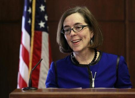 Oregon Governor Kate Brown speaks at the state capital building in Salem