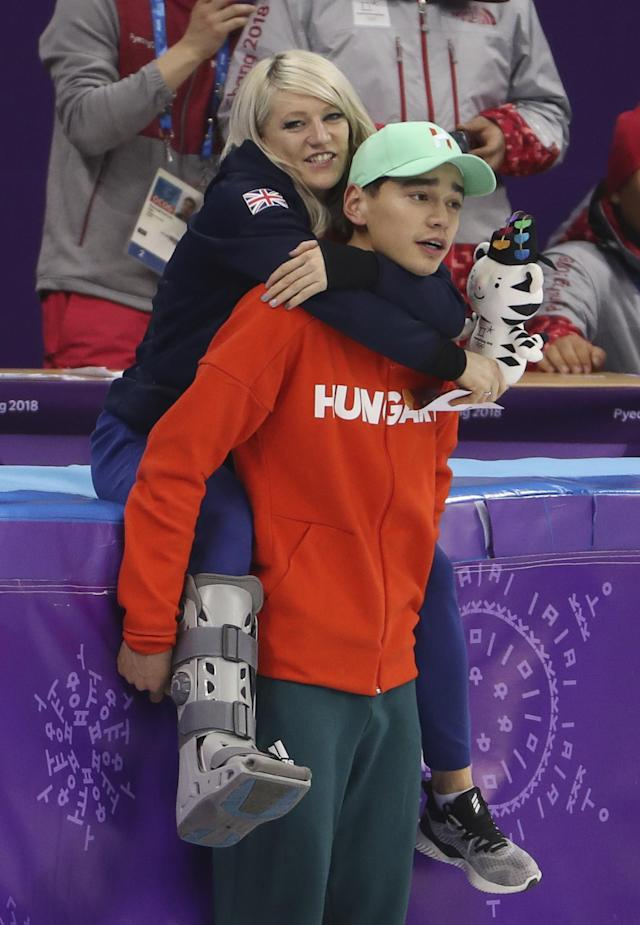 Short Track Speed Skating Events - Pyeongchang 2018 Winter Olympics - Men's 5000m Relay Final - Gangneung Ice Arena - Gangneung, South Korea - February 22, 2018 - Short track speed skater Elise Christie of Britain rides piggyback on on gold medallist Sandor Liu Shaolin of Hungary. REUTERS/Lucy Nicholson