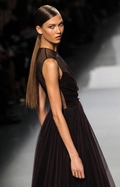 A model wears a creation from designer Christian Dior as part of the Fall-Winter, ready-to-wear 2013 fashion collection, during Paris Fashion week, Friday, March 2, 2012. (AP Photo/Christophe Ena)