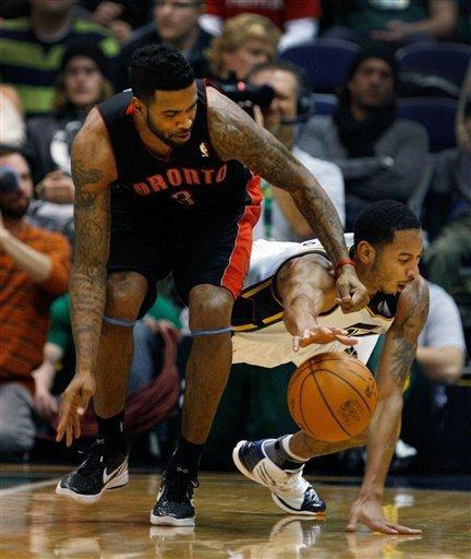 Utah Jazz guard Devin Harris, right, dives for a loose ball as Toronto Raptors forward Gary Forbes, left, joins in the action during the first half of their NBA basketball game in Salt Lake City, Wednesday, Jan. 25, 2012. (AP Photo/Steve C. Wilson)