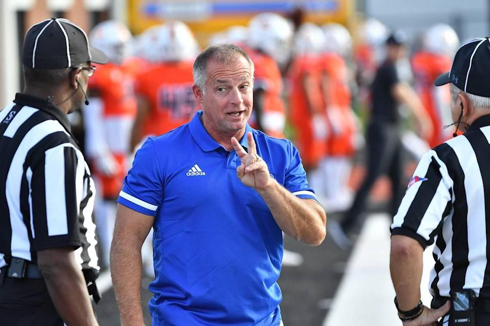 Presbyterian head football coach Kevin Kelly talks with referees before the start of the game with Campbell. The Presbyterian Blue Hose and the Campbell Fighting Camels met in a non-conference football game in Buies Creek, N.C. on September 18, 2021.