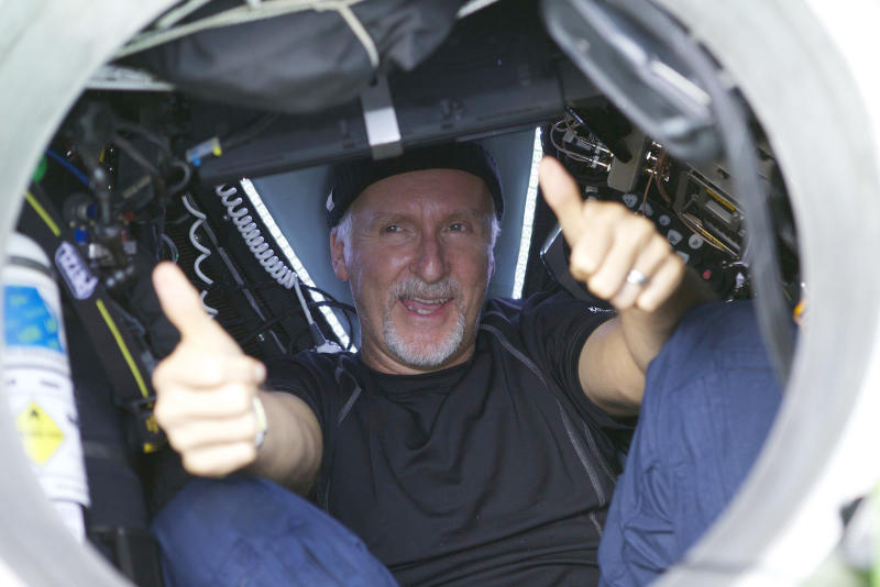 In an image provided by National Geographic filmmaker James Cameron gives two thumbs-up as he emerges from the Deepsea Challenger submersible Monday March 26, 2012 after his successful solo dive in the Mariana Trench, the deepest part of the ocean. The dive was part of Deepsea Challenge, a joint scientific expedition by Cameron, the National Geographic Society and Rolex to conduct deep-ocean research. (AP Photo/Mark Theissen, National Geographic)