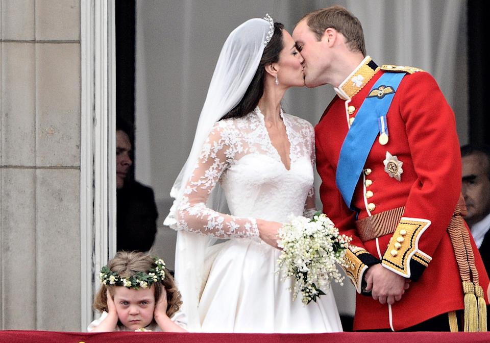 Britain's Prince William kisses his wife Kate, Duchess of Cambridge, on the balcony of Buckingham Palace, after their wedding service, on April 29, 2011, in London.