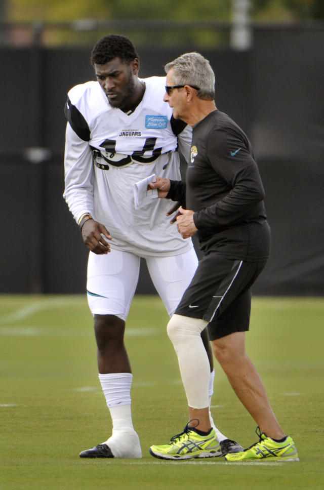 Jacksonville Jaguars wide receiver coach Jerry Sullivan, right, works with Justin Blackmon during NFL football practice, Wednesday, Oct. 2, 2013, in Jacksonville, Fla. Blackmon returned to the team Wednesday, after a four-game suspension for violating the league's substance-abuse policy. (AP Photo/The Florida Times-Union, Will Dickey)