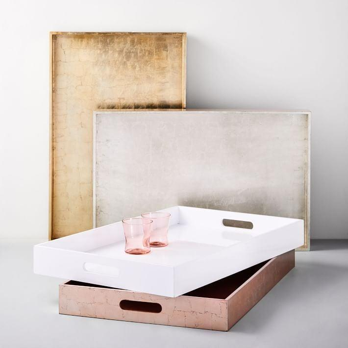 <p>These pretty <span>West Elm Lacquer Wood Trays</span> ($42, originally $70) will help make their space feel more organized and personal.</p>
