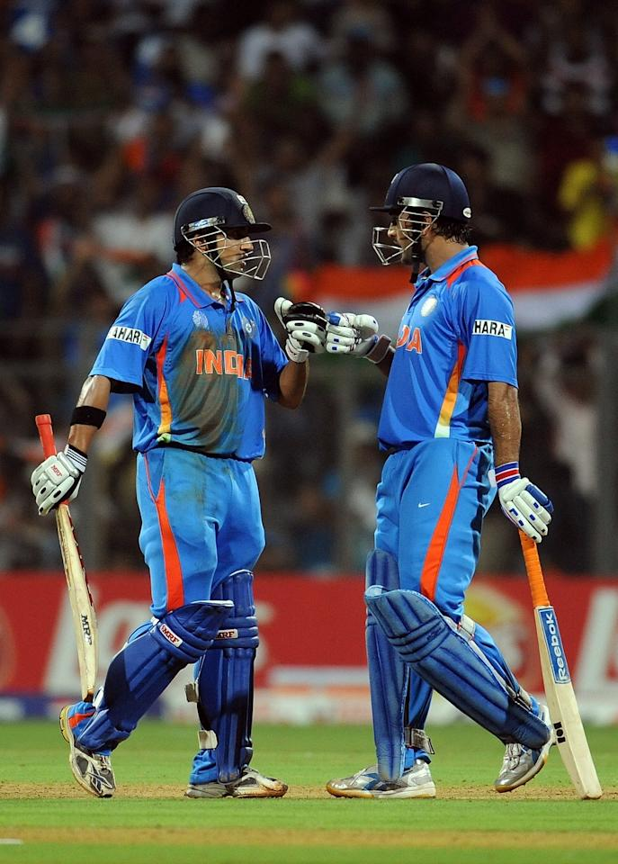 Indian batsman Mahendra Singh Dhoni (R) congratulates Gautam Gambhir after a boundary during the final of ICC Cricket world Cup 2011 match between India and Sri Lanka at The Wankhede Stadium in Mumbai on April 2, 2011. AFP PHOTO/Prakash SINGH (Photo credit should read PRAKASH SINGH/AFP/Getty Images)