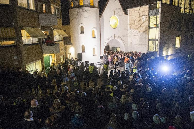 People gather as Norwegian Muslims create a human peace ring around a synagogue in Oslo, Norway, on February 21, 2015