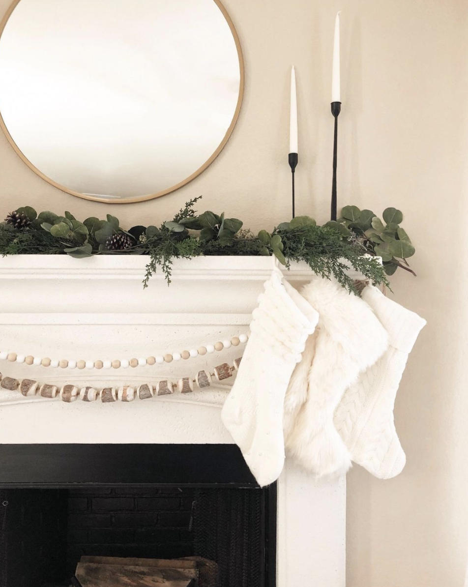 "<p>If you're going the less-is-more approach, make a simple garland look complete by adding a double strand of wooden beads to the mix. </p><p><em>See more at <a href=""https://www.instagram.com/p/B45enPmAzh5/"" rel=""nofollow noopener"" target=""_blank"" data-ylk=""slk:According to Mandy"" class=""link rapid-noclick-resp"">According to Mandy</a>. </em></p><p><a class=""link rapid-noclick-resp"" href=""https://www.amazon.com/SadiaPower-Garland-Farmhouse-Christmas-Decorations/dp/B087Y3YC2B?tag=syn-yahoo-20&ascsubtag=%5Bartid%7C10072.g.34484299%5Bsrc%7Cyahoo-us"" rel=""nofollow noopener"" target=""_blank"" data-ylk=""slk:SHOP BEADED GARLAND"">SHOP BEADED GARLAND</a></p>"