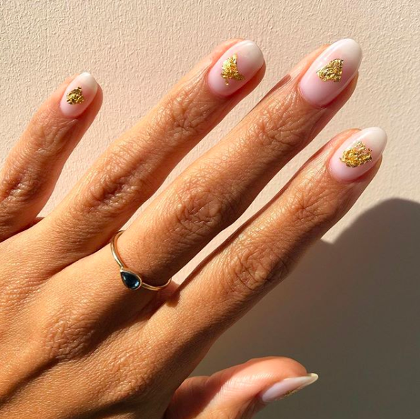 A sprinkle of gold leaf makes an otherwise subtle mani feel special. If you don't have some on hand, a dollop of gold polish will do the trick.
