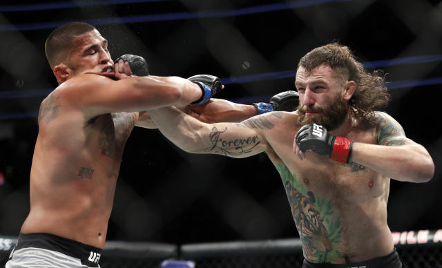 Michael Chiesa, right, lands a right hand against Anthony Pettis during his loss to Pettis at UFC 226 in Las Vegas. (AP Photo/John Locher)