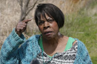 """Joi McCondichie, whose grandmother was Tulsa Race Massacre survivor Eldoris McCondichie, speaks during an interview on a recreational trail in Tulsa, Okla., on Saturday, April 10, 2021, which was once the railroad tracks that Black Tulsans walked along to escape the violence of the Tulsa Race Massacre a century earlier. McCondichie is a native of this city, but her life and career in public education kept her away from home for decades. When she returned to Tulsa from Los Angeles with her then-teenage son, she moved into a home just off of the Osage Prairie Trail on the city's north side. """"I believe God led me here because he had a task for me,"""" McCondichie says. (AP Photo/Sue Ogrocki)"""