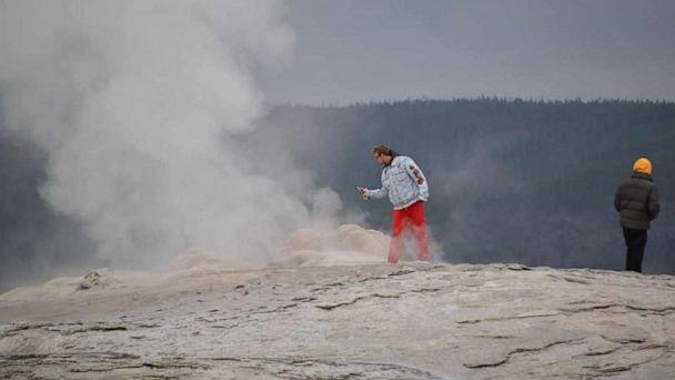 PHOTO: Two men face criminal charges for walking onto Old Faithful Geyser in Yellowstone National Park. (Kimberly Guilliams/Facebook)