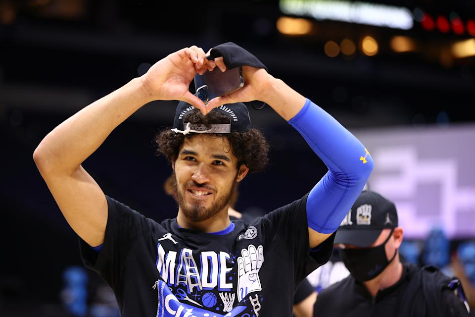 INDIANAPOLIS, IN - MARCH 30: Johnny Juzang #3 of the UCLA Bruins celebrates their win over the Michigan Wolverines in the Elite Eight round of the 2021 NCAA Division I Men's Basketball Tournament held at Lucas Oil Stadium on March 30, 2021 in Indianapolis, Indiana. (Photo by Jamie Schwaberow/NCAA Photos via Getty Images)