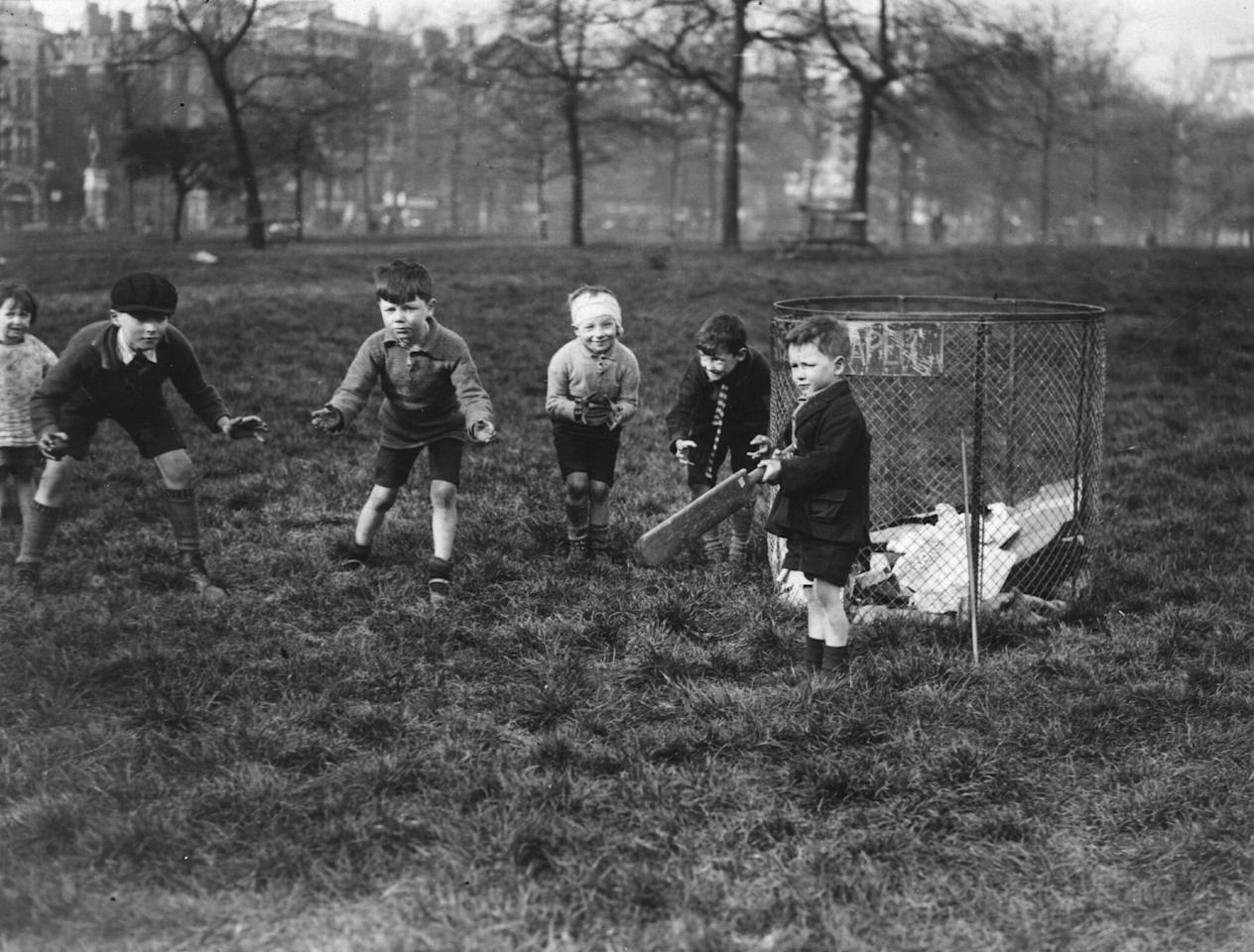 circa 1926:  A group of young children playing cricket in London's Hyde Park.  (Photo by Topical Press Agency/Getty Images)