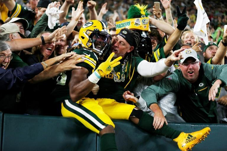 Jones celebrates his third touchdown of the night against the Detroit Lions with Green Bay fans during the second half at Lambeau Field (AFP/Wesley Hitt)
