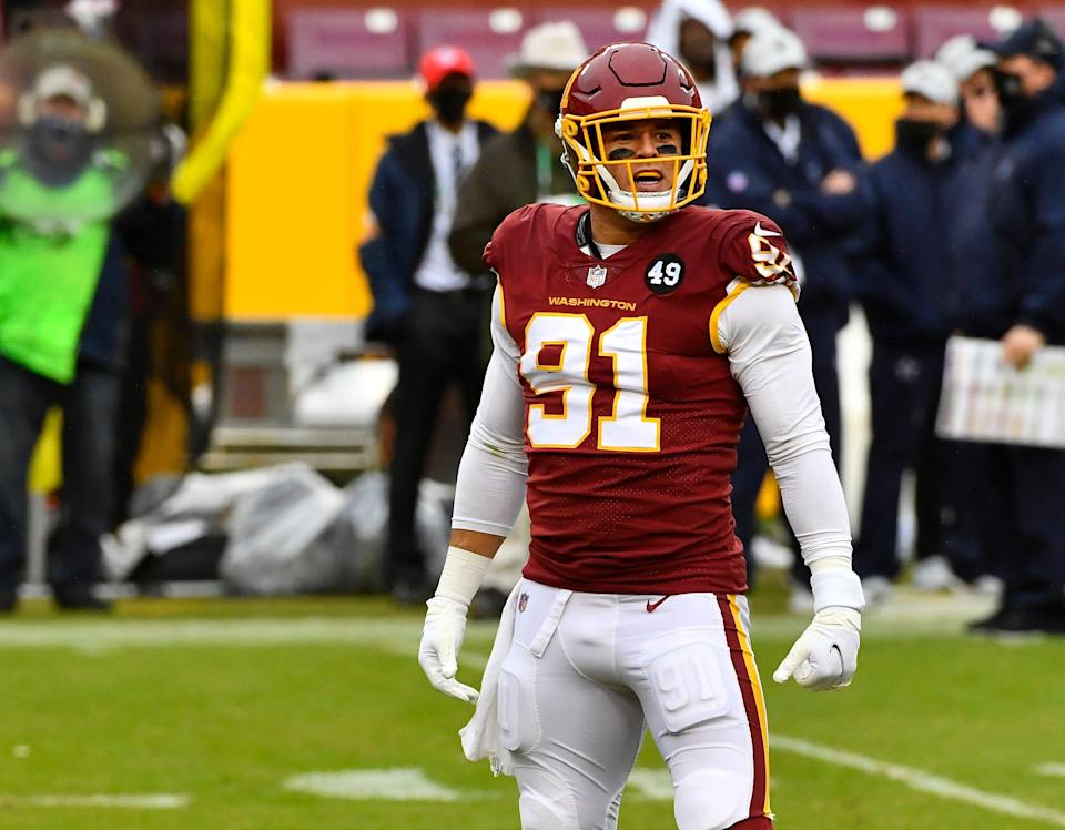 Washington Football Team defensive end Ryan Kerrigan (91) reacts after recording a sack against the Dallas Cowboys during the second half at FedExField.