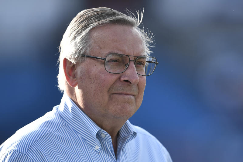 FILE - In this Aug. 8, 2019, file photo, Terry Pegula, owner of the Buffalo Bills, walks on the field before an NFL preseason football game against the Indianapolis Colts in Orchard Park, N.Y. The Bills have informed county officials they will not use an early and one-time opt-out clause to terminate their lease at New Era Field. The team's decision, sent in a letter to Erie County Executive Mark Poloncarz on Friday, Jan. 31, 2020, was considered a formality, but in no way rules out the possibility of the Bills one day playing at new facility in downtown Buffalo.  (AP Photo/Adrian Kraus, File)