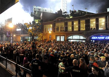 Fans gather after the Boston Red Sox won the MLB baseball's World Series by beating St. Louis Cardinals in Game 6, at Landsdown Street near Fenway Park in Boston October 30, 2013. REUTERS/Tory Germann (UNITED STATES - Tags: SPORT BASEBALL)