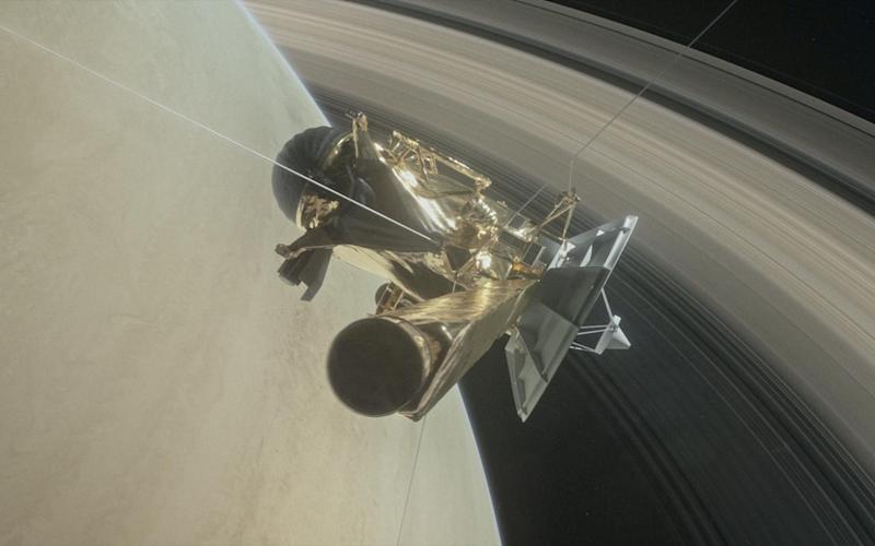 Illustration of NASA's Cassini spacecraft about to make one of its dives between Saturn and its innermost rings - REUTERS