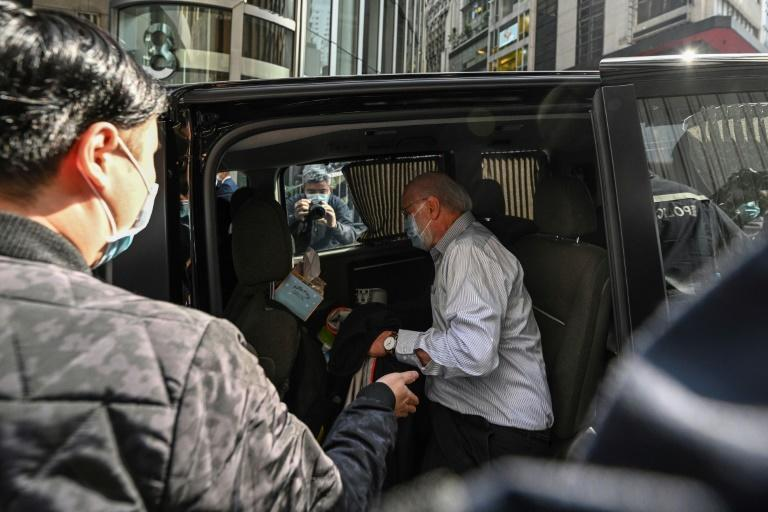 John Clancey, a US lawyer with a Hong Kong law firm known for taking up human rights cases, is led away by police during a major crackdown on January 6, 2020