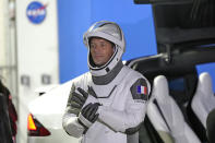 European Space Agency astronaut Thomas Pesquet of France, adjusts his glove as he talks to family and friends before a launch attempt Friday, April 23, 2021, at the Kennedy Space Center in Cape Canaveral, Fla. Four astronauts will fly on the SpaceX Crew mission to the International Space Station scheduled for launch on April 23, 2021. (AP Photo/John Raoux)