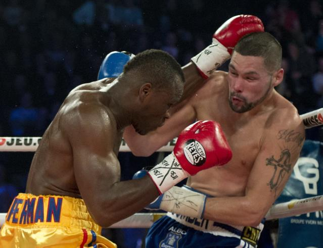 Adonis Stevenson (L) trades blows with Tony Bellew in their WBC light heavyweight title fight in Quebec City early Sunday, Dec. 1, 2013. (AP)