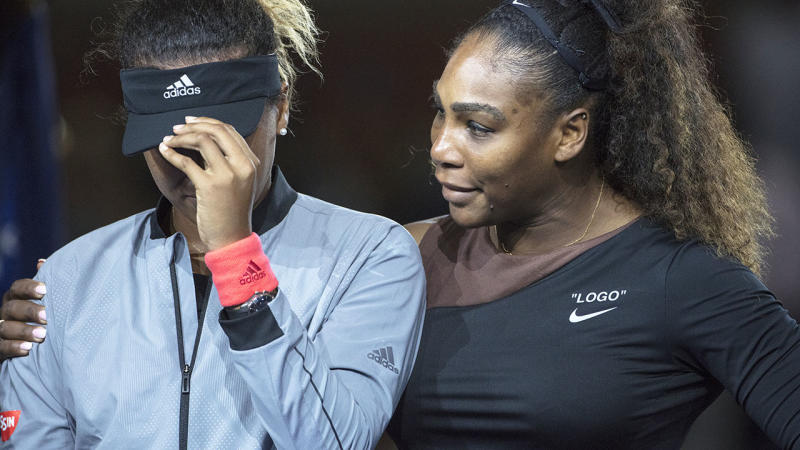 Serena Williams embraces Naomi Osaka as she cries at the presentations. More