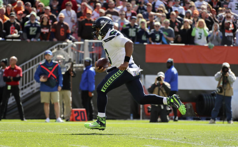 Seattle Seahawks quarterback Russell Wilson rushes for a 16-yard touchdown during the first half of an NFL football game against the Cleveland Browns, Sunday, Oct. 13, 2019, in Cleveland. (AP Photo/Ron Schwane)