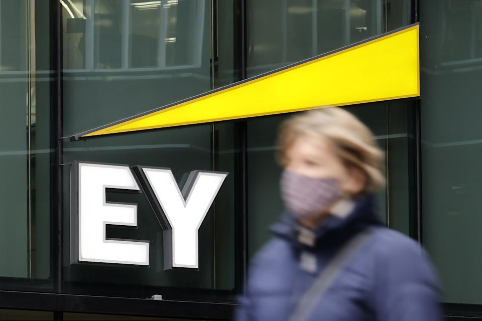 Pedestrians walk past the offices of accounting and auditing firm EY, formerly Ernst & Young, in London. Photo: Tolga Akmen/AFP via Getty Images