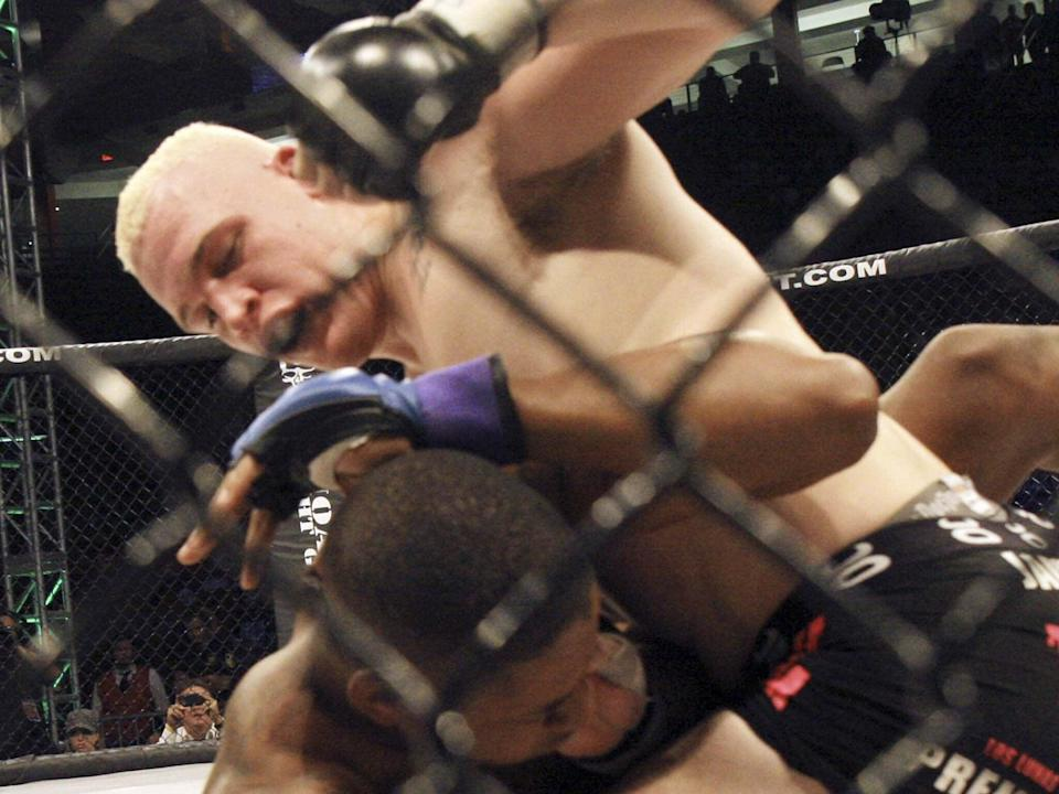 <p>File Image: Tyler East of Albuquerque, top , pounds on Prince McLean of Cincinnati, Ohio in the Heavy weight 265 lbs. match during the MMA Fight Pit Genesis on Saturday, 13 August 2011</p> (Albuquerque Journal/ Zumapress)