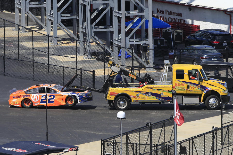 TALLADEGA, AL - APRIL 25: #22: Joey Logano, Team Penske, Ford Mustang Autotrader is pulled to the garage on a tow truck after a wreck during the running of the 52nd Annual Geico 500 NASCAR Cup Series race on April 25, 2021 at the Talladega Superspeedway in Talladega, Alabama.  (Photo by David J. Griffin/Icon Sportswire via Getty Images)