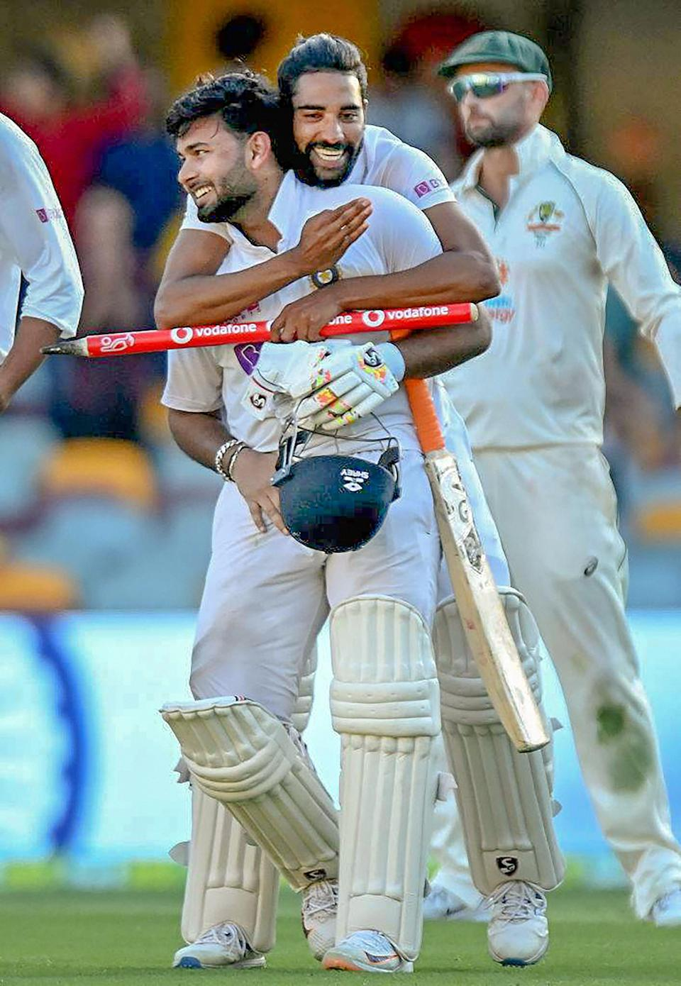 Indian players Shardul Thakur and Mohd Siraj celebrate after defeating Australia by three wickets on the final day of the fourth cricket test match at the Gabba, Brisbane, Australia, on Tuesday, 19 January 2021. India won the four test series 2-1.