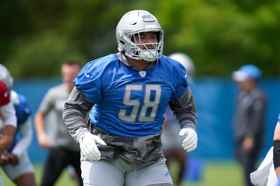 Detroit Lions offensive tackle Penei Sewell runs a drill during NFL football practice in Allen Park, Mich., Thursday, June 3, 2021.