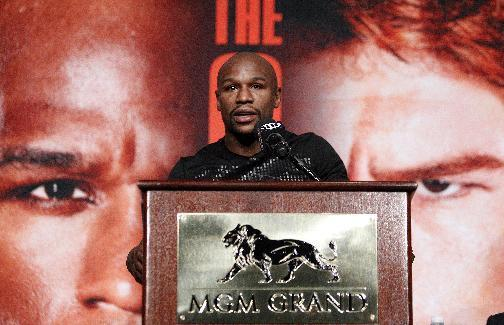 Boxer Floyd Mayweather speaks during a press conference in Las Vegas, Wednesday, Sept. 11, 2013. Mayweather is scheduled to fight on Saturday against Carnelo Alvarez, for Mayweather's WBA Super World and Alvarez's WBC junior middleweight titles. (AP Photo/Las Vegas Review-Journal, John Locher)