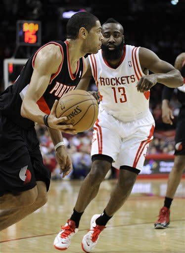 Portland Trail Blazers' Nicolas Batum, left, drives by Houston Rockets' James Harden (13) in the first half of an NBA basketball game on Friday, Feb. 8, 2013, in Houston. (AP Photo/Pat Sullivan)