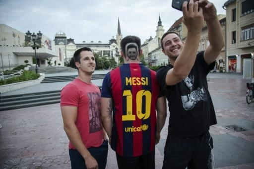 Selfies with a football fan sporting a hair 'tattoo' of Argentinian superstar Lionel Messi in Novi Sad, Serbia, on June 10