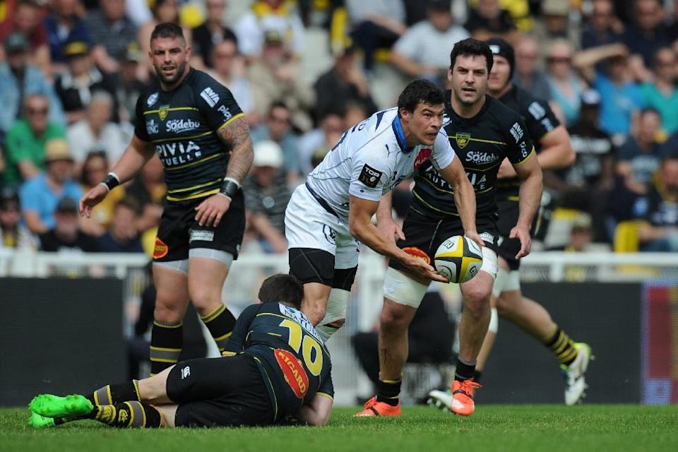 The mood is not ideal in the Montpellier camp after head coach Jake White opted to dispense with Toulon-bound fly-half Francois Trinh-Duc (C) for the crunch clash with Toulon (AFP Photo/Xavier Leoty)