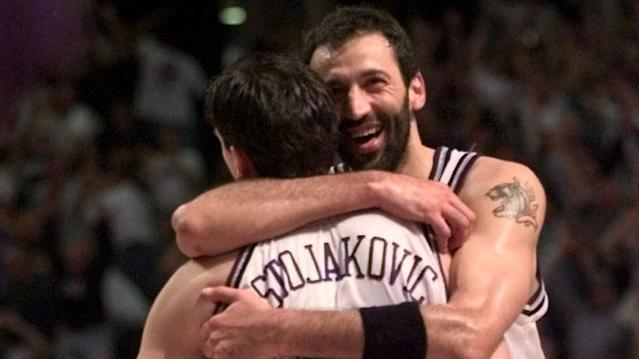 Vlade Divac, Peja Stojakovic hug during a 1999 Sacramento Kings game