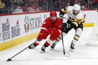 Detroit Red Wings defenseman Filip Hronek (17) protects the puck from Pittsburgh Penguins center Alex Galchenyuk (18) in the third period of an NHL hockey game Saturday, Dec. 7, 2019, in Detroit. (AP Photo/Paul Sancya)