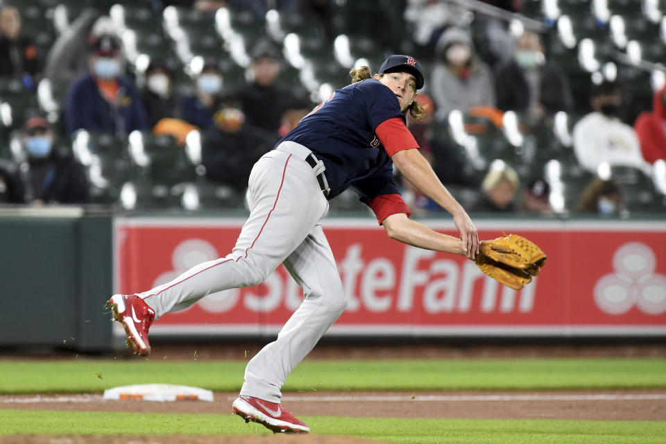 Boston Red Sox starting pitcher Garrett Richards throws to first base to get out Baltimore Orioles' Maikel Franco in the fourth inning of a baseball game, Saturday, May 8, 2021, in Baltimore. (AP Photo/Will Newton)