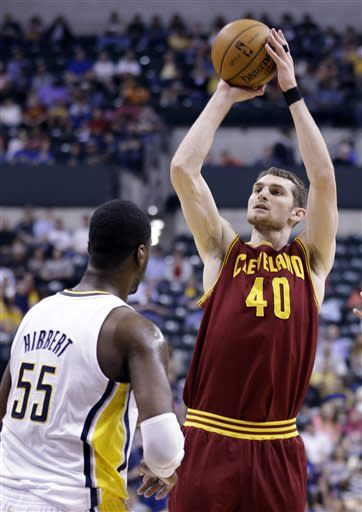 Cleveland Cavaliers center Tyler Zeller, right, shoots over Indiana Pacers center Roy Hibbert in the first half of an NBA basketball game in Indianapolis, Tuesday, April 9, 2013. (AP Photo/Michael Conroy)